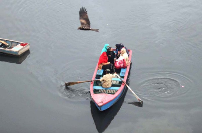 A family enjoying boat riding in River Ravi in the provincial capital