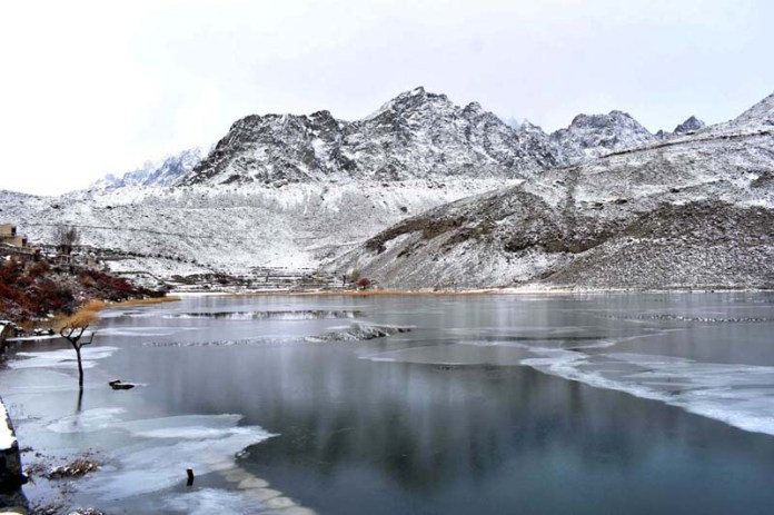 An attractive and eye catching view of freeze snow covered Borith Lake, Borith Lake is a lake in Gojal, Hunza Valley in Gilgit-Baltistan, Pakistan. Borith is a hamlet in the surroundings of the Borith lake, which is a part of Ghulkin, Gojal, in the upper Hunza. Borith Lake approximately 2 km to the north of Ghulkin