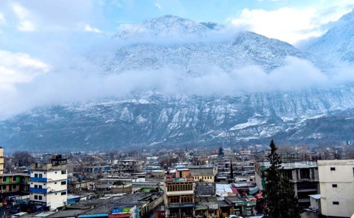 An attractive and eye catching view of clouds hovering over the snow covered mountain after snow fall in the city