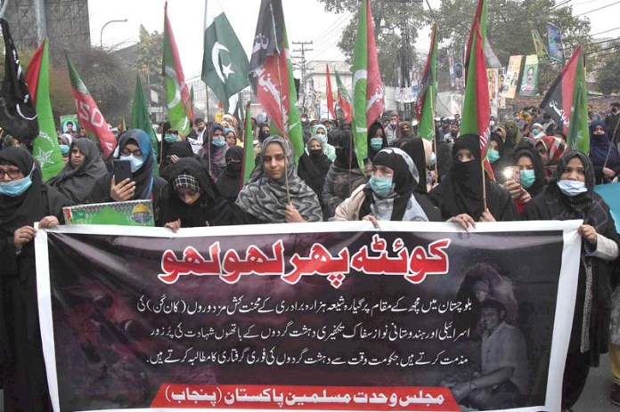 Activists of Majlis Wahdat-e-Muslimeen Pakistan(MWM) protest against the killing of 11 workers of Shiite Hazara community outside at the Lahore Press club
