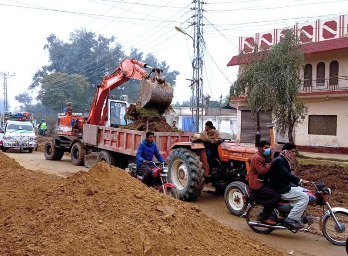 Laborers works on road project underway near Darbar Mahal to convert single roads into one-way green belt road