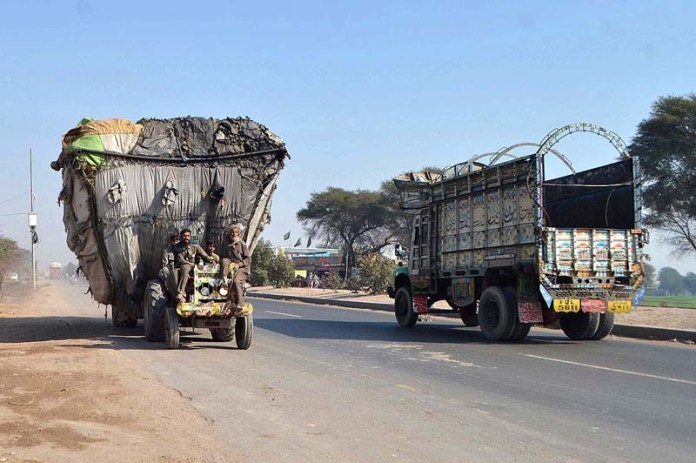 A tractor trolley heavily loaded on the way against the traffic may cause any mishap and needs the attention of concerned authorities