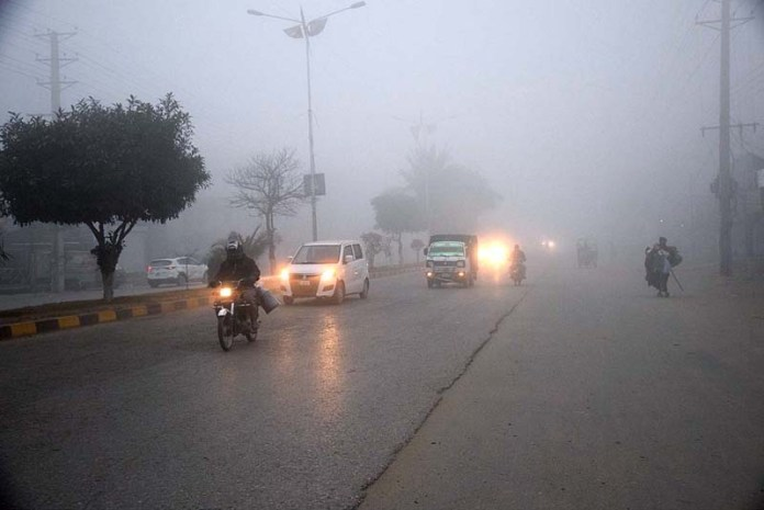 Vehicles on the way during thick fog that engulfs the whole city during morning time