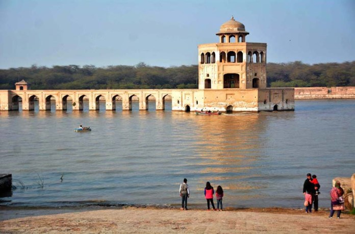 People spending weekend with their families at 17th-century Mughal era complex Hiran Minar Tomb