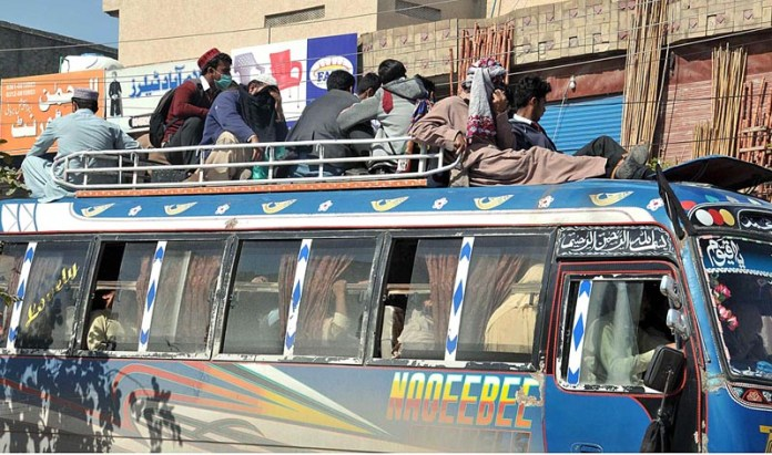People travelling on a passenger bus's rooftop may cause any mishap and needs the attention of concerned authorities