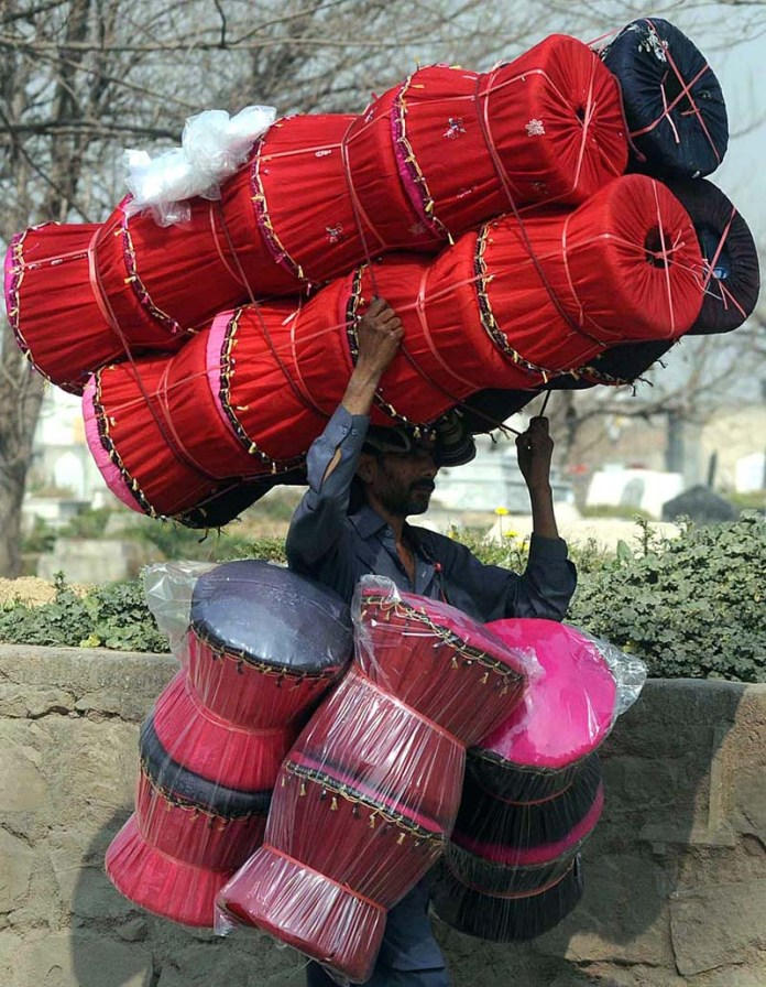 A street vendor displaying traditional stools to attract the customers at Peerwadhai area