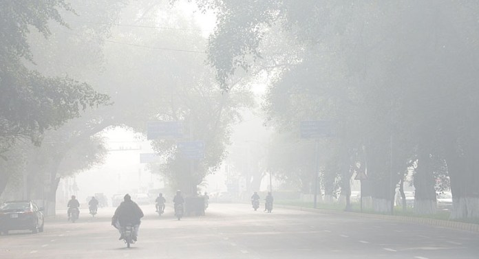 A view of thick fog that engulfs whole the city during morning time