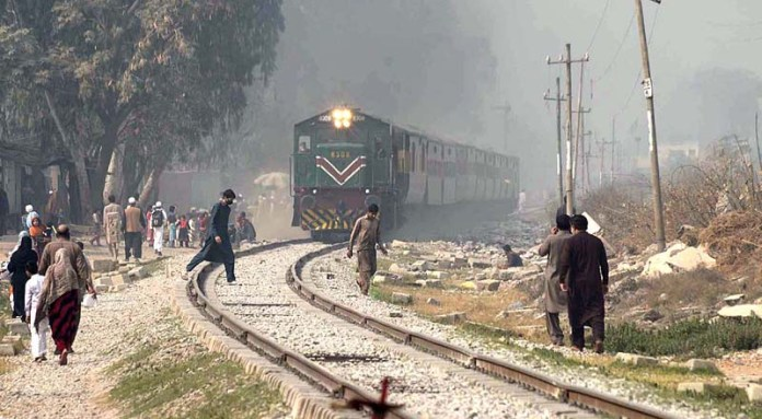 People walking and around the rail tracks while a train approaching may cause any mishap and needs the attention of concerned authorities