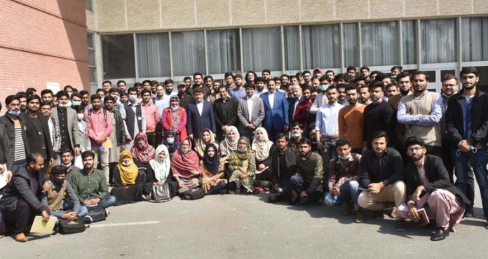 A group photo of Abid Elyas Dar, Project Director of Angro Fertilizers Limited with participants of seminar at University of Agriculture Faisalabad