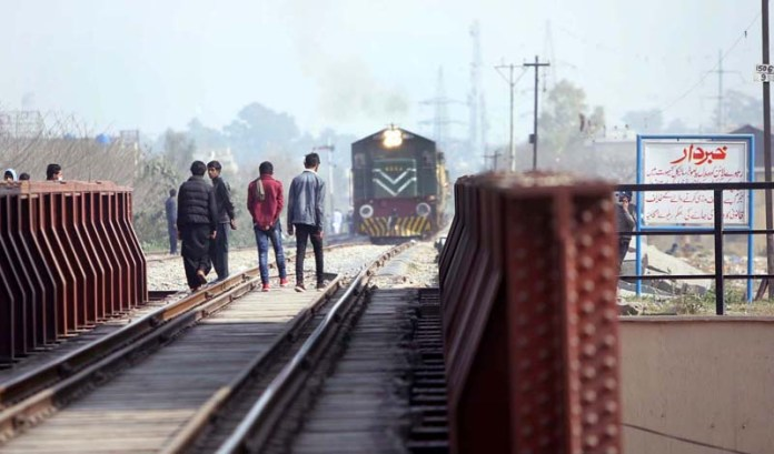 Youngsters on the way walking on the railways track at Marrir Chowk as train plying on the same track may cause a mishap and needs the attention of the concerned authorities