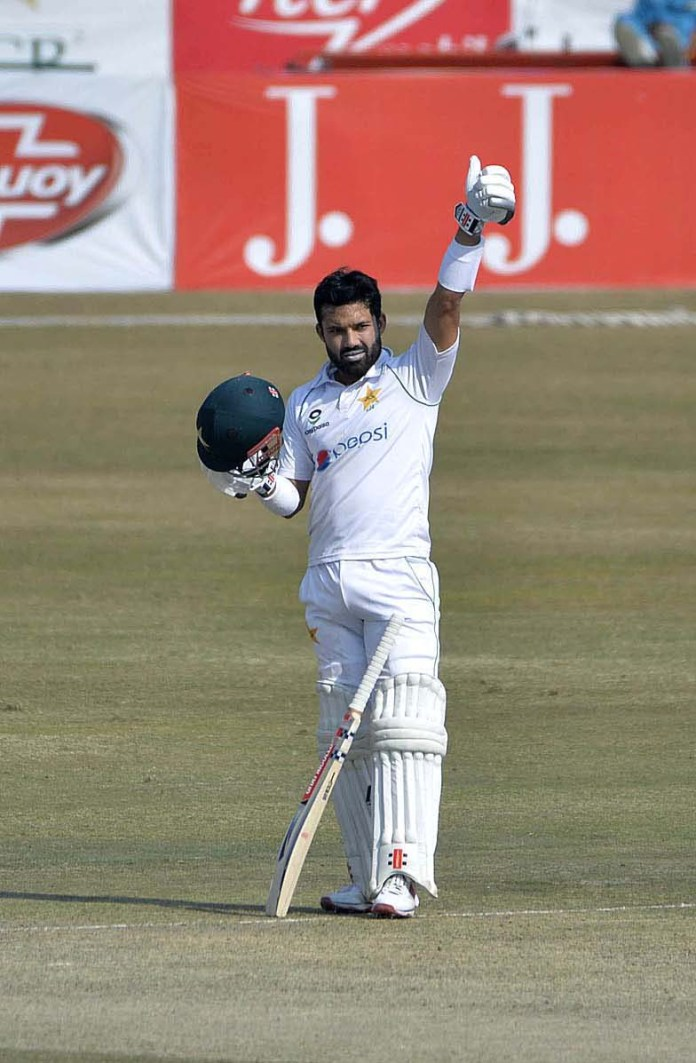 Pakistani batsman Mohammad Rizwan celebrates after scoring a century (100 runs) during the fourth day of the second Test cricket match between Pakistan and South Africa at the Rawalpindi Cricket Stadium