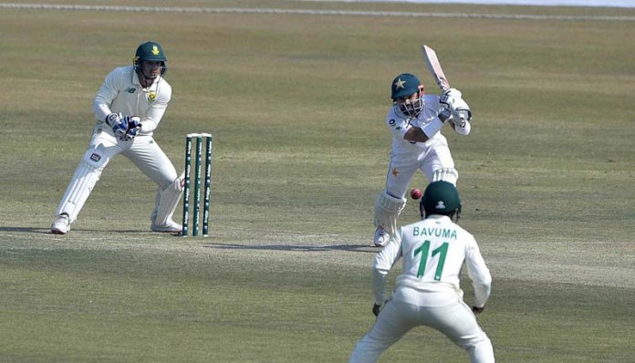 Pakistani batsman Mohammad Rizwan plays a shot during the fourth day of the second Test cricket match between Pakistan and South Africa at the Rawalpindi Cricket Stadium