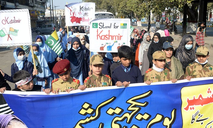 Children participating in a PTI rally to mark Kashmir Solidarity Day at Mall Road