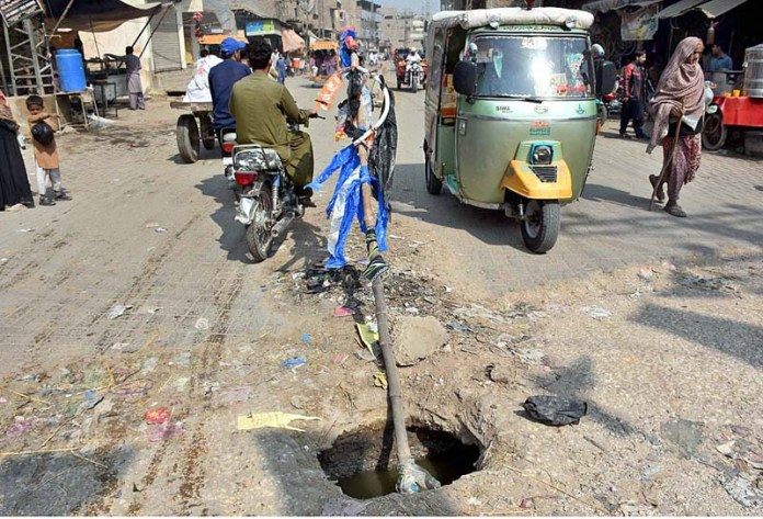 A view of open sewerage main-hole in the middle of Naudero Road and needs the attention of the concerned authority