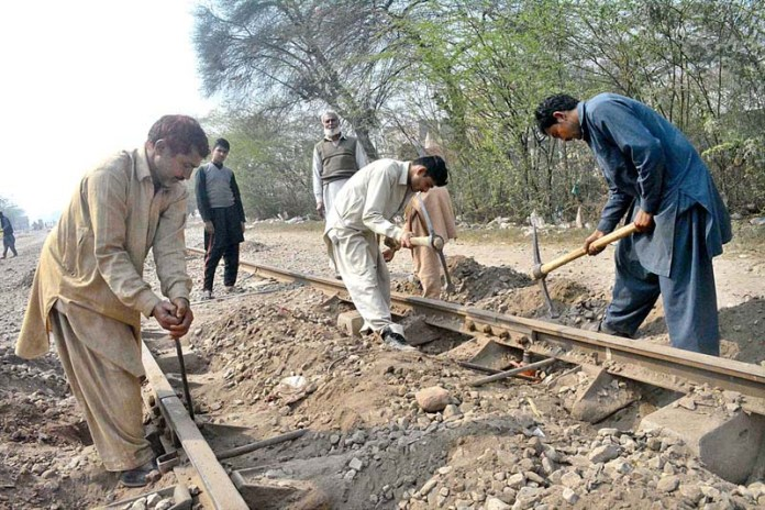 Railway staffers busy in their work on railway tracks near old Civil Lines