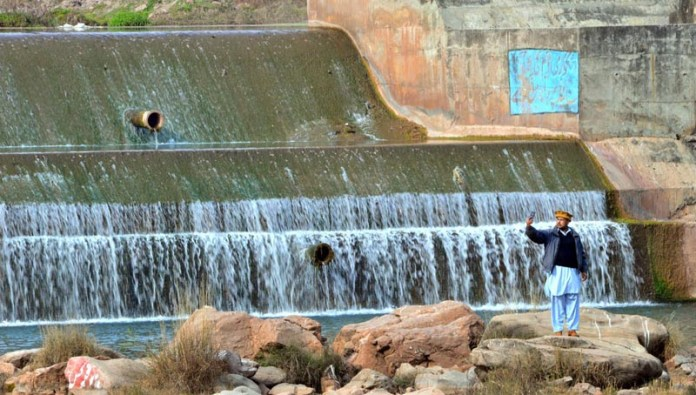 A visitor capturing the moments at Angoori Dam