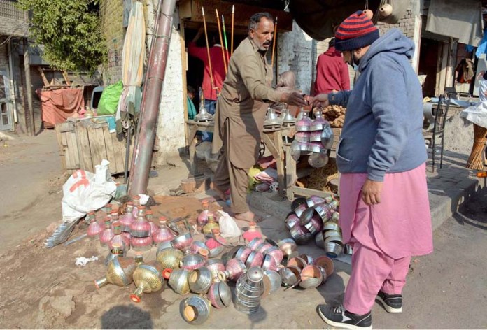 A vendor selling different parts of traditional smoking pipe at Rajbah Road