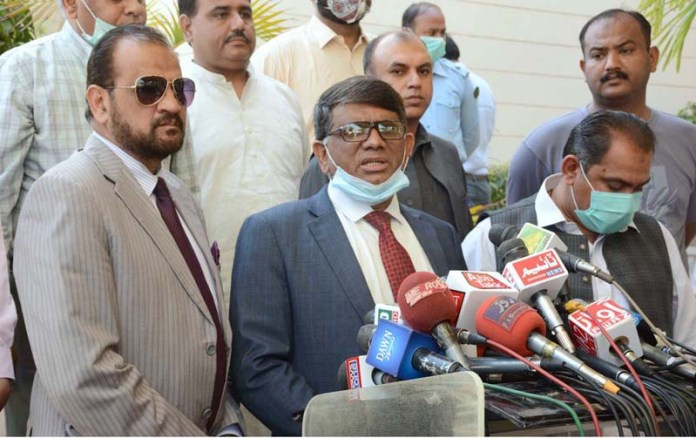 Provincial Election Commissioner Ejaz Anwar Chauhan talking to media persons at Sindh Assembly Building