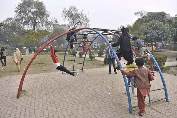 Children enjoying at playing area in a local park to spend their holiday