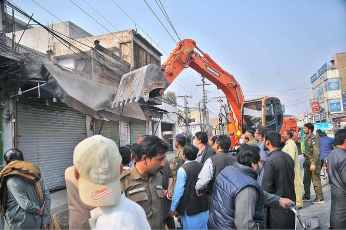 MDA and Anti-encroachment Cell staffers removing encroachments during anti-encroachment campaign near Nawanshahr Chowk