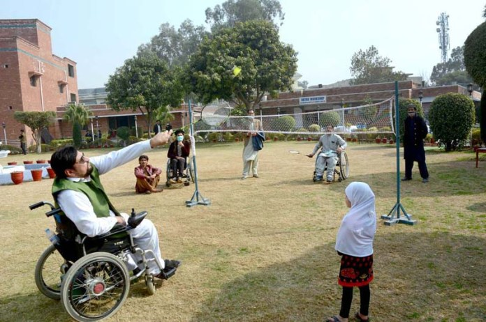 Disable persons are busy in playing badminton at Paraplegic Centre