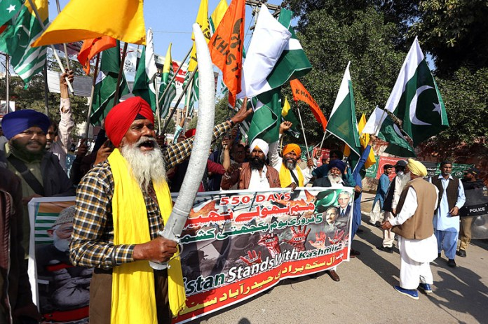 Sikh community participating in a rally to mark Kashmir Solidarity Day outside Press Club