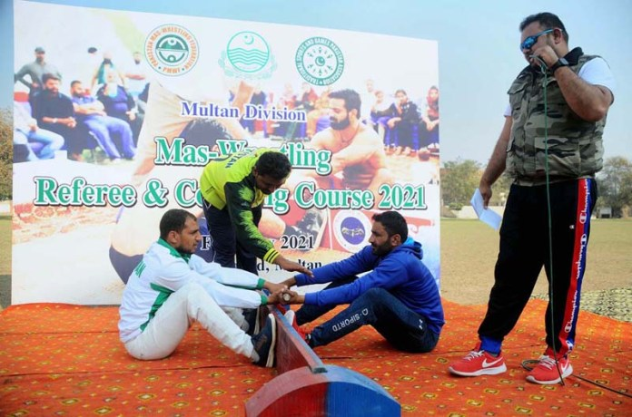 Youngsters participating in Mas-Wrestling Referee & Coaching Course organised by Multan Divisional at Sports Ground