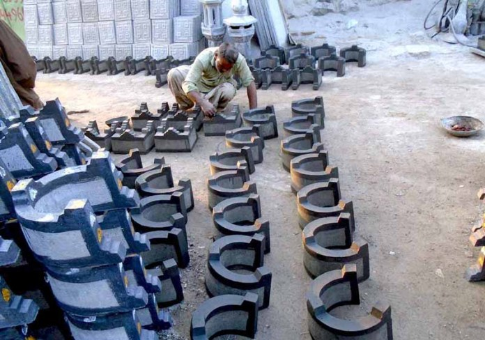 A worker busy in making cement stove
