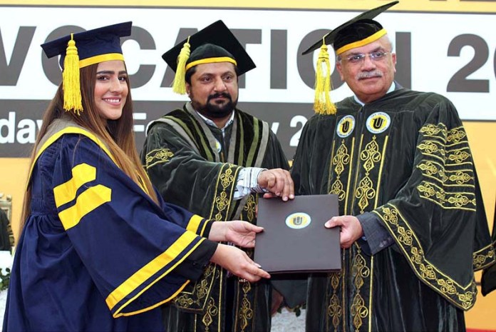 Vice chancellor of ISRA University Pro. Dr Nazir Ashraf Leghari giving away degree to successful student during ISRA university 18th convocation 2021 at Hala Naka