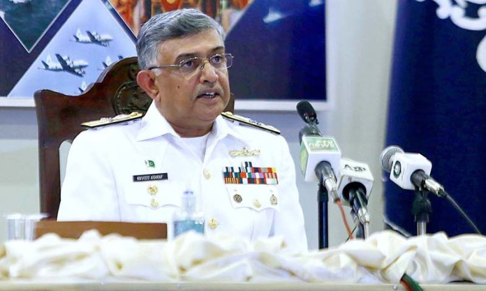 Pakistan's Navy Admiral Naveed Ashraf speaks to journalists as he briefs them about the Multinational 'Aman 2021' Exercise