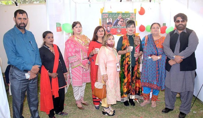 A group photo of PTI Women Wing stall during the 4th National Women's Day 2021 exhibition at Frere Hall