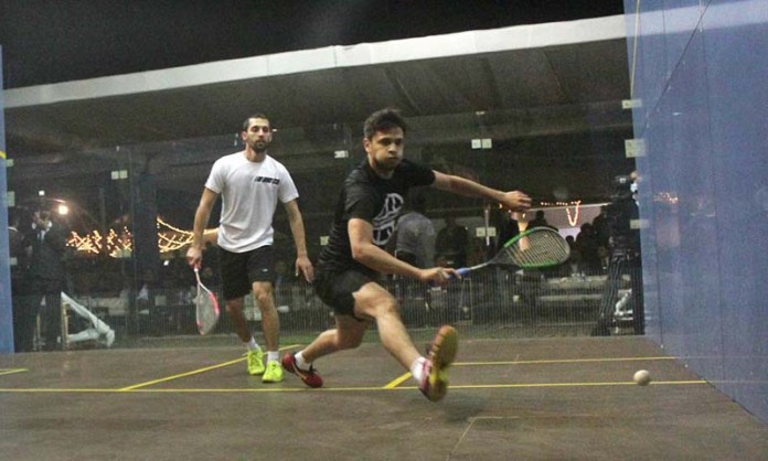Players in action in final squash match during BISL 4 & Southern Punjab International Squash Tournament 2021 at DHA Arena