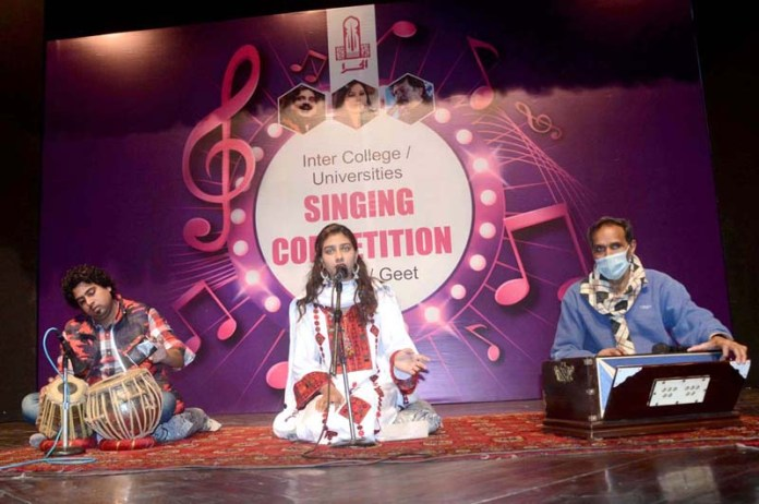 A girl participating in Inter College/Universities Singing Competition Ghazal/Geet at Arts Council
