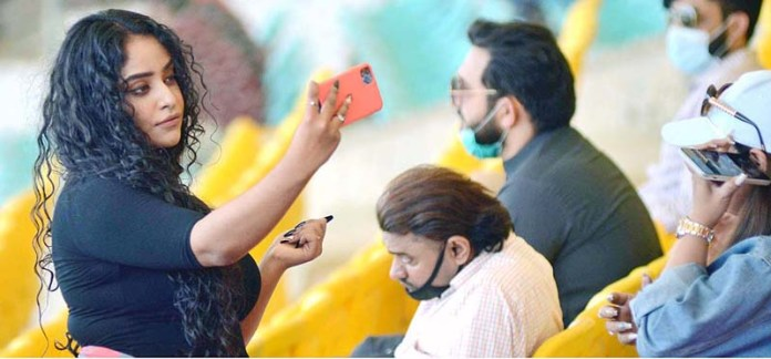 Spectators enjoying during Pakistan Super League (PSL) T20 cricket match between Karachi Kings and Peshawar Zalmi played at the National Stadium