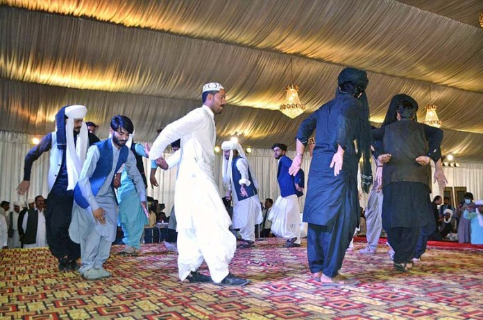 Students performing traditional dance to celebrate Baloch Culture Day at Balochistan University
