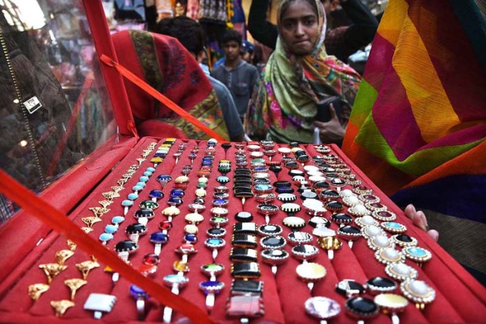 A vendor displaying different kind of rings in a local market to earn livelihood