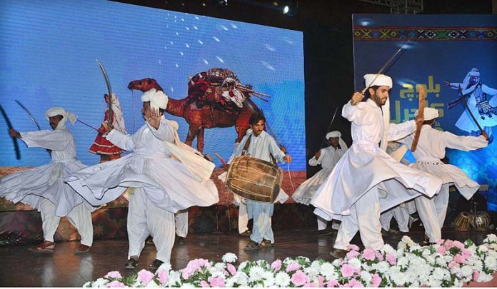 Traditional dancers performing during a function to mark Baloch Culture Day arranged by Provincial Information and Culture Department at Al-Hamra