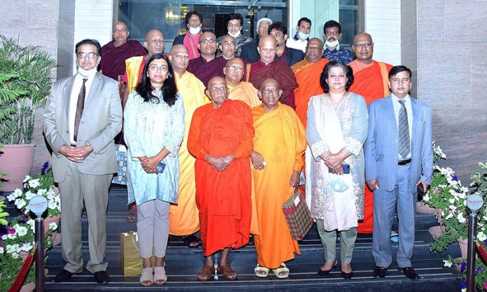 Federal Secretary for Information and Broadcasting, Mrs. Shahera Shahid in a group photo with Sri Lankan Buddhist Monks' delegation headed by Ven Dr. Walpola Piyananda Thero & Ven Dr. Kirinde Assaji Thero