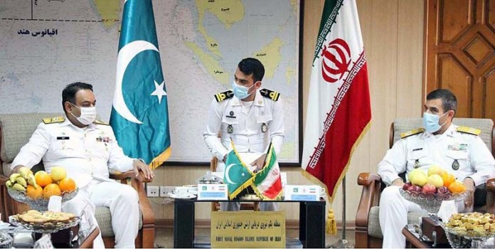 PN Mission Commander exchanging views with Commander 1st Naval District of Islamic Republic of Iranian Navy during Pakistan Navy Ship AZMAT visit to Port Bandar Abbas