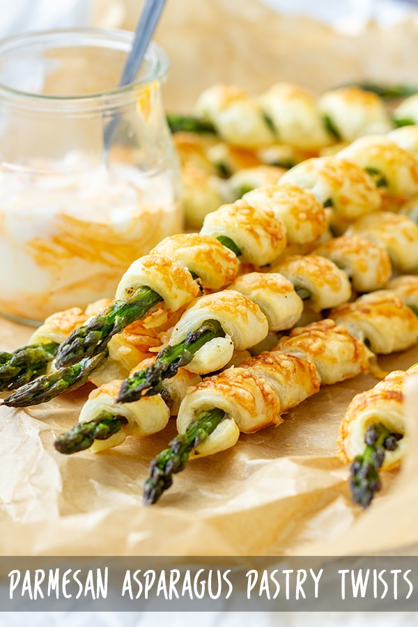 Parmesan Asparagus Pastry Twists are cool looking appetizers ready in less than 30 minutes. Wrap Asparagus in puff pastry, sprinkle with Parmesan, bake and enjoy! #appetizeraddiction #parmesan #asparagus #puffpastry #recipe #appetizers #partyfood
