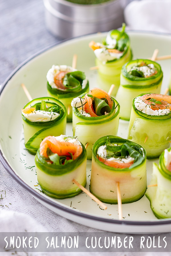 Smoked salmon cucumber rolls are refreshing appetizer bites, perfect for any occasion. Cream cheese and salmon are wrapped in slices of cucumber and seasoned to taste. #appetizeraddiction #salmon #cucumber #rolls #appetizers #fingerfood #partyfood #recipe #canapes