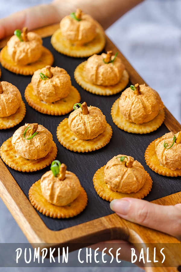 These bite-size mini pumpkin cheese balls appetizers are easy to make and only take minutes to put together. #pumpkin #halloween #appetizers #cheeseballs #partyfood #fingerfood