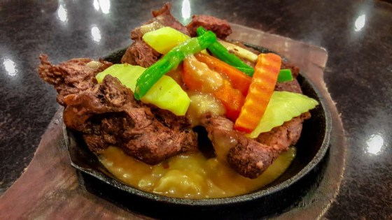 Bulalo Steak Php469 Tender beef shank served on a sizzling platter with buttered vegetables and gravy.