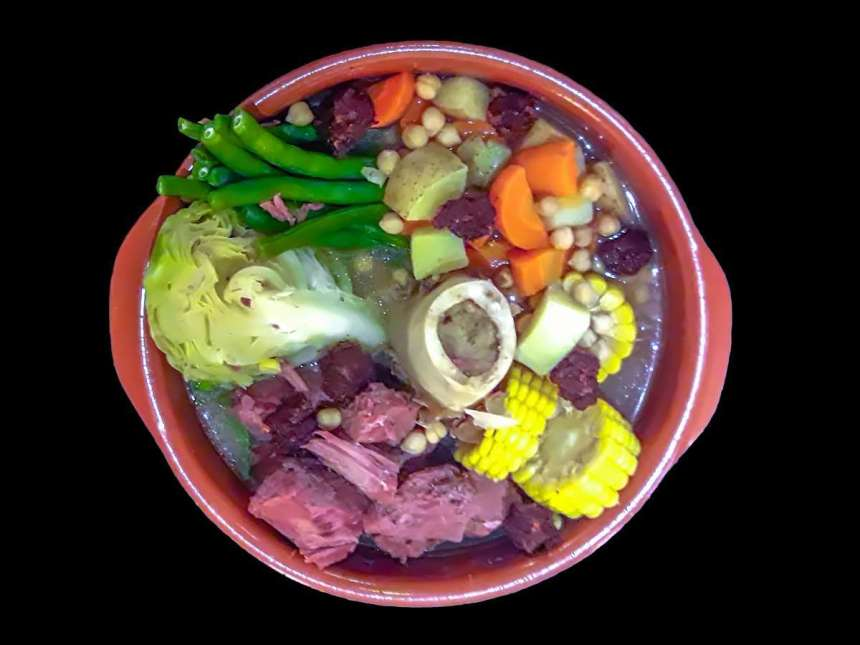 "Corned Beef Bulalo Php995 XO46: ""Bulalo...the word alone conjures visions of decadent beef shanks, boiled for hours on the bone with its rich marrow still intact. It is served with heapings of fresh vegetables swimming in a flavouful, robust broth. An original dish of Central Luzon, Bulalo has become a classic in Philippine cookery. At XO46, our Bulalo is prepared with fresh corned beef and a less greasy but supremely flavorful broth."""