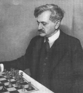 Emanuel Lasker, gazing at the chess board