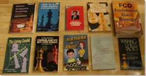 "many chess books incl ""Beat That Kid in Chess"""