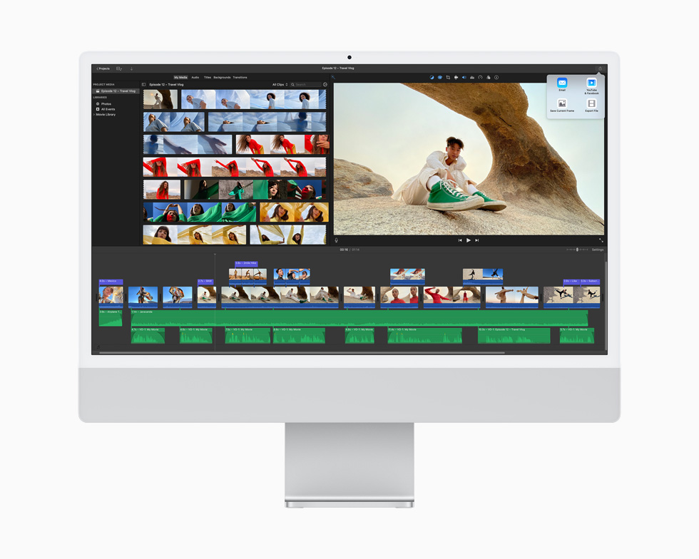 A video project is edited using the iMovie app, displayed on a silver iMac.