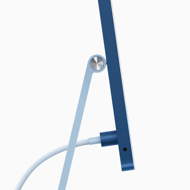 Side view of blue iMac showing power connector and woven, color-matched cable.