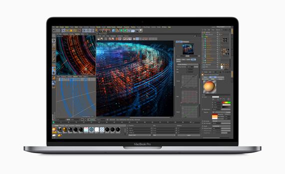 MacBook Pro showing renderings of 3D models on screen.