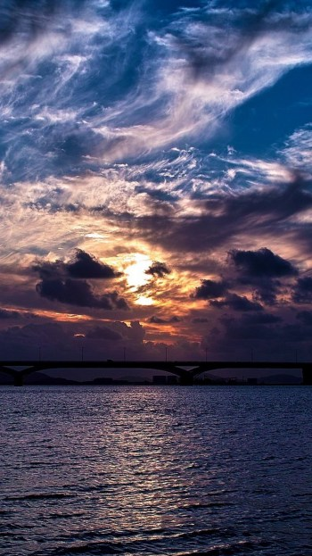 dramatic-clouds-sunset-over-bridge-iphone-6-wallpaper